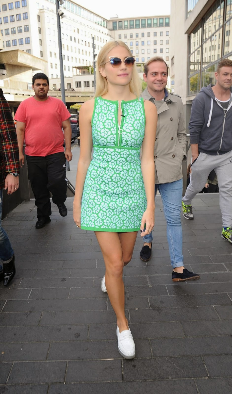 Pixie Lott arrives in a summery green dress at the ISSA London Fashion Week Show