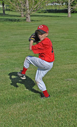 Noah playing baseball