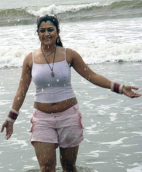 Indian sexy and Hot Actress Kushboo looking at Beach Photos