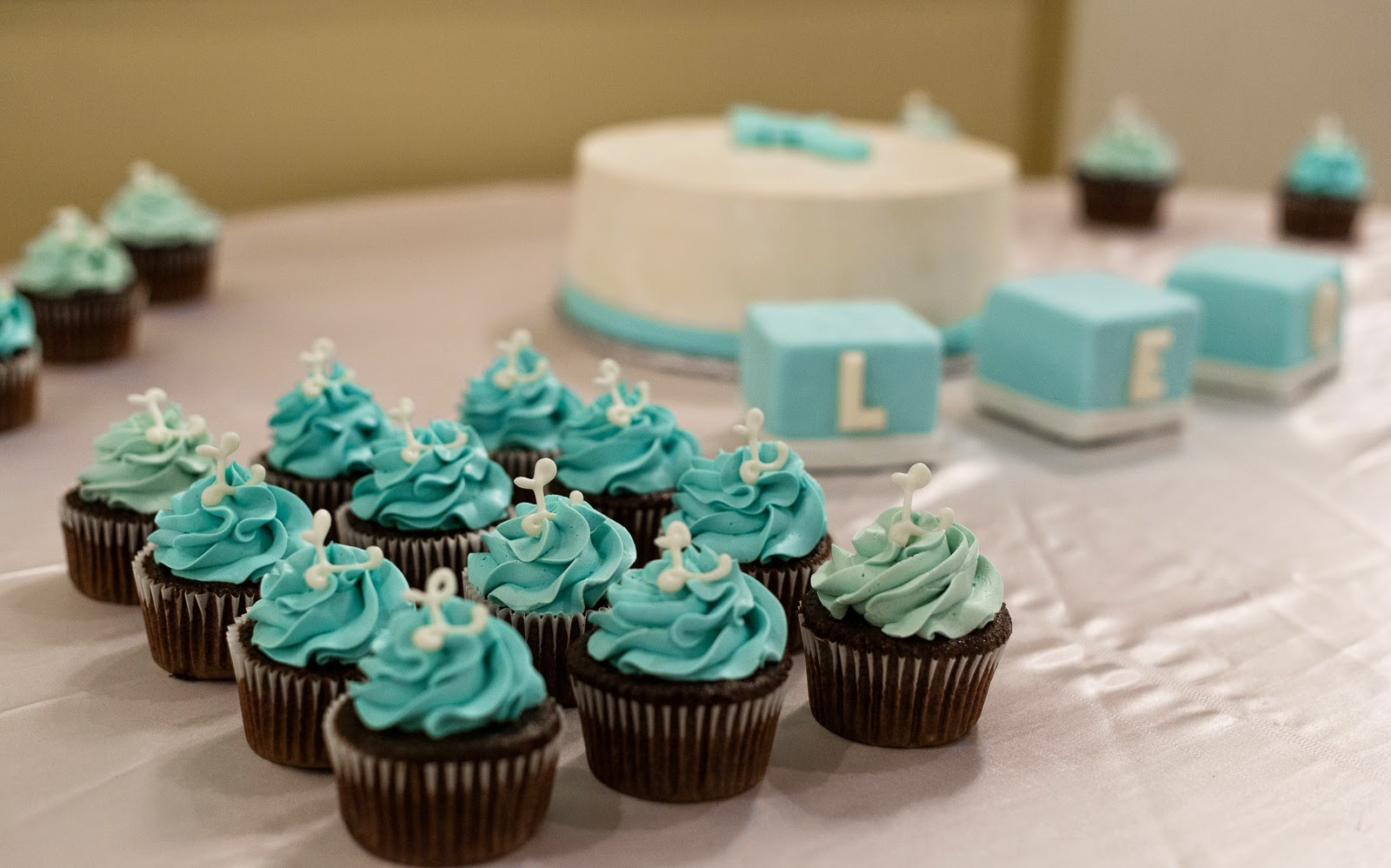 crafting baker baby boy s baptism cake with cupcakes