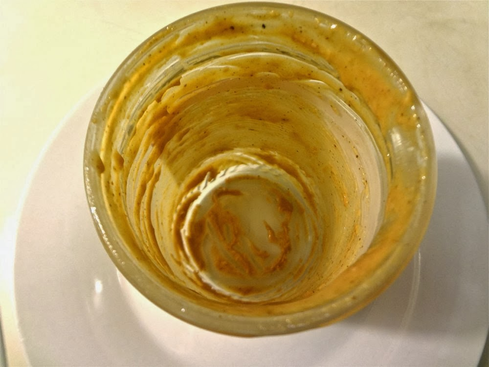A dirty peanut butter jar that needs cleaning!
