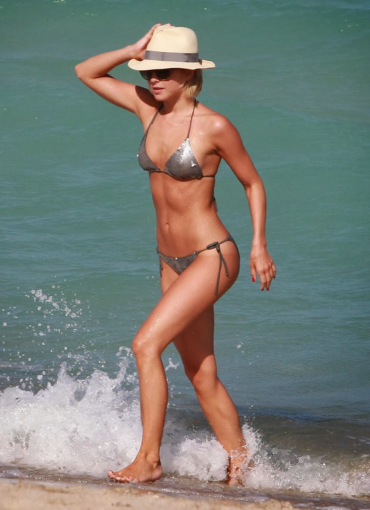With her slim body and Dark blond hairtype without bra (cup size 33B) on the beach in bikini