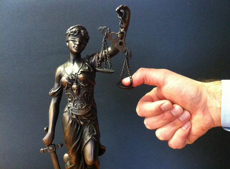 Image result for finger on scale of justice