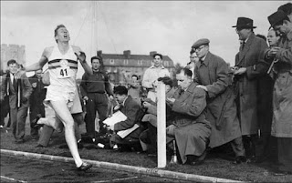 Roger Bannister at the finish line when he was the first person to run a mile under four minutes, May 6, 1954