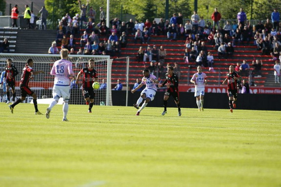 Evian player Saber Khelifa shoots from his own half to score against Nice