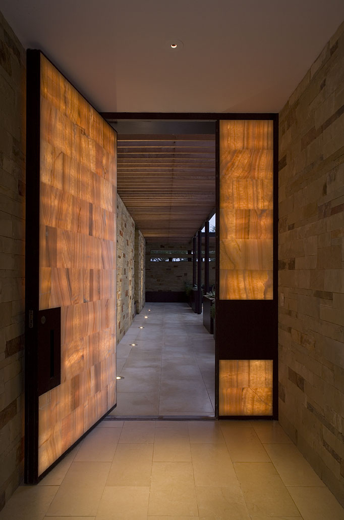 Dick clark architecture product corner pivot doors make for Grand entrance doors