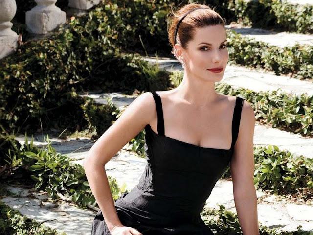 Actress Sandra Bullock sexy in black dress