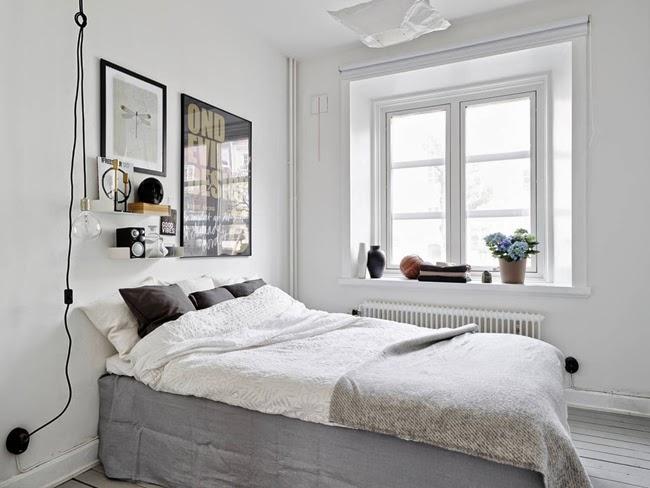 Dormitorio black&white con toques dorados