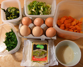 Fresh Eggs, Carrots, Leeks, Parsley, Greens, and Cheese