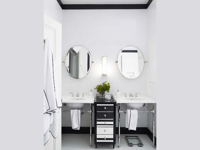 his her bathroom sink oval mirrors basin marble white tile black baseboard