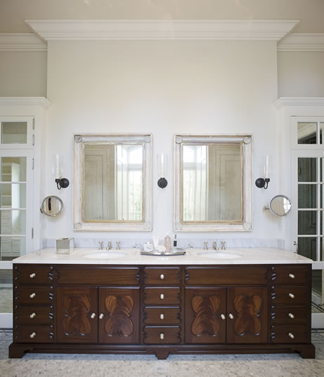 white bathroom tile floor dark wood cabinetry lighting sink bathtub