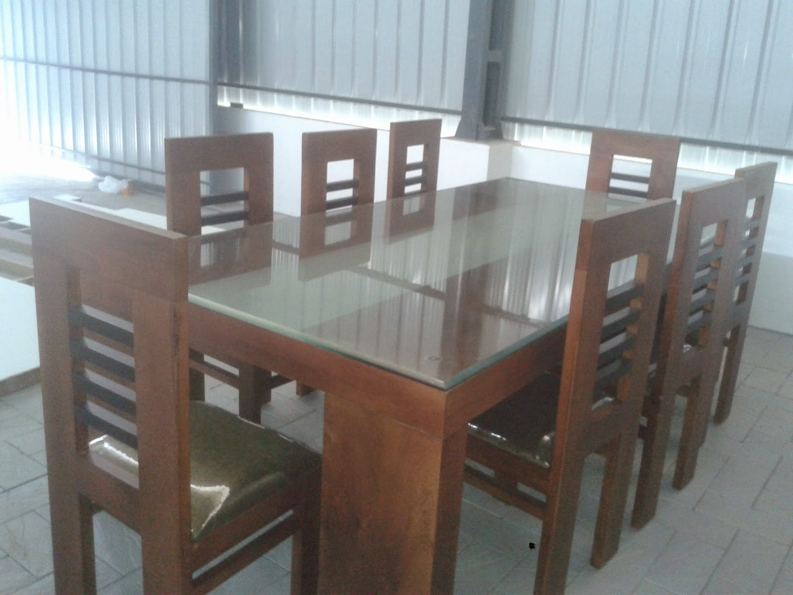 Kerala style carpenter works and designs attractive for Wooden glass dining table designs