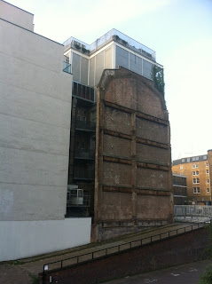 Retaining wall of partly demolished building, Paul Street, London