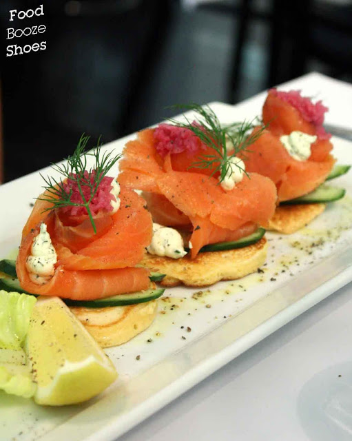 ... with sliced smoked salmon, pickled Spanish onion and dill sour cream