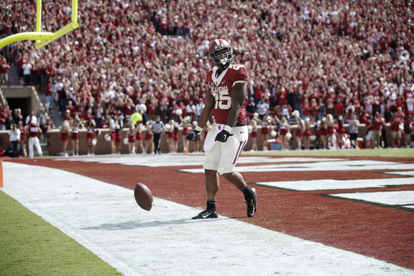 Running back Joe Mixon #25 of the Oklahoma Sooners celebrates a touchdown against the West Virginia Mountaineers October 3, 2015 at Gaylord Family-Oklahoma Memorial Stadium in Norman, Oklahoma.