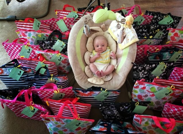 infant surrounded by thermal totes