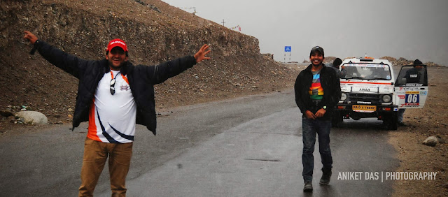 With the Raid comin to an end on the 12th of October 2013, 2 guys just like me (Samrat Yadav & Parminder Thakur, who were competitors in the rally) were clueless on how to get back home from Leh. Samrat had to go to Chandigarh, Parminder to Shogi and I had to get back to my college (National Institute of Design) in Ahmedabad.After a lot of fuss and confusion, Maruti Suzuki Motorsports decided that we were the capable bunch to hand over the keys to, of a competition car (SX4)thatneeded to be delivered to Manali. We jumped at the offer. We knew we could figure things out once we reach Manali.So without wasting anytime, we tagged along Harpreet Bawa in his Gypsy and left for a roadtrip that would test our survival skills!Little did we know what lay ahead. Everyone else had made plans of leaving the next day since something was brewing. We didnt have a clue. I think that just made things a lot better!But, when i look back i knew who to blame. Read through the pics, and lets hope it makes you live through the ordeals of the insane 'Afterparty' that commenced in the evening of the 12th of October, 2013. Happy & dandy, we were thoroughly excited about this roadtrip that would practically make us do a second round of the rally. We started capturing every milestone & settlement as we knew such an opportunity would be hard to find in the future. We wanted to keep a record of thijourney. Thank god for that! With 400+kms to Manali, we had a long trip ahead of us.  Some beautiful scenes like these did make us sing! Oh the joys of freedom 'Happy Journey' Yeah, thanks for that. Samrat waits as Parminder gets the toll ticket. Thats the SX4 by the way. She looked like she was back from a big war. I guess she was We've all got issues. So HIMANK's no exception. Yes HIMANK, we are enjoying the valley- now that the rally is over Temperatures kept falling and we saw clouds in the distance. This meant only one thing- IT WAS GOING TO SNOW! We jumped out of our cars and were on our feet bal