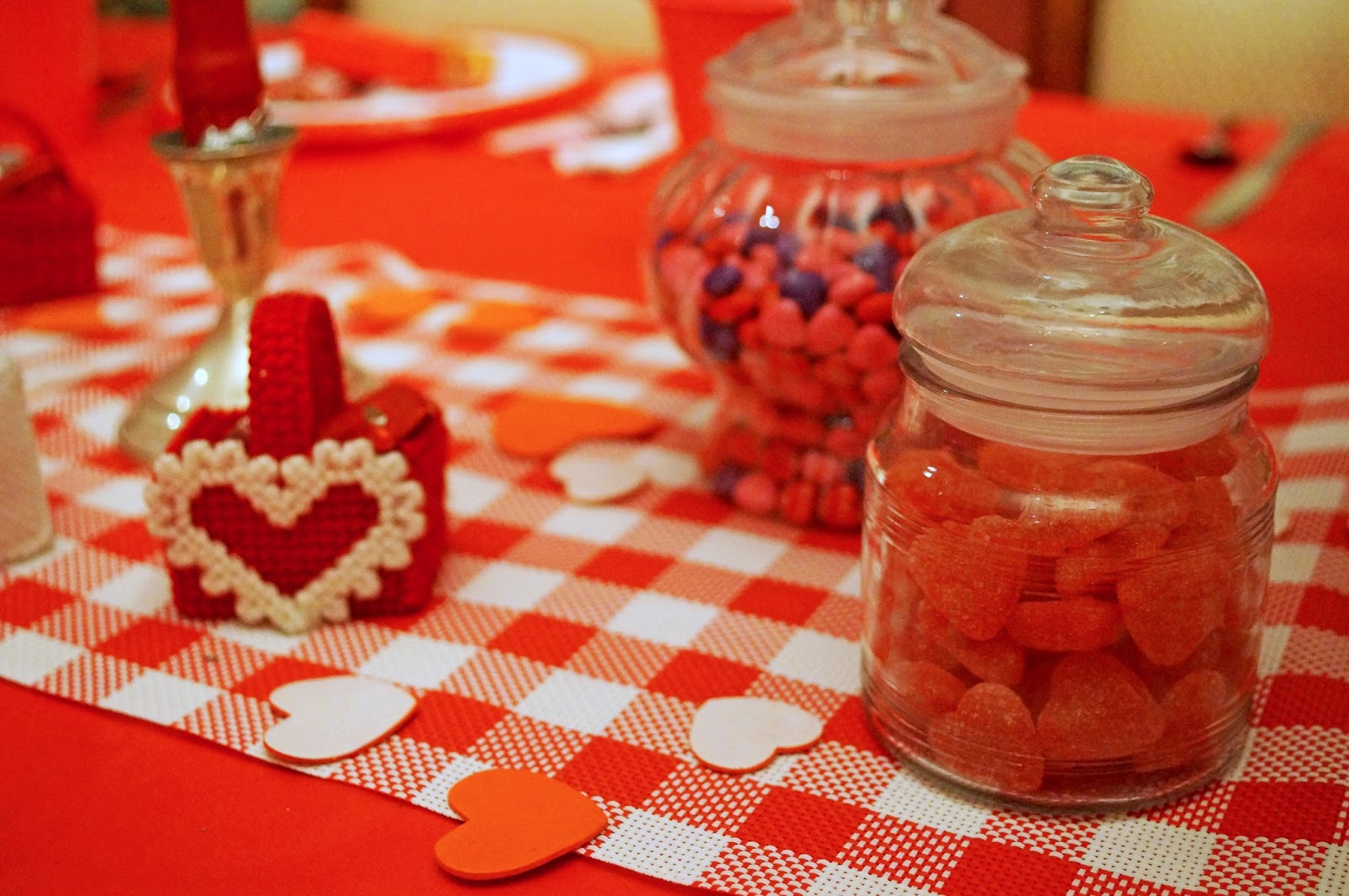 A cheap but cute Valentines Day decoration is to just fill jars with candy!