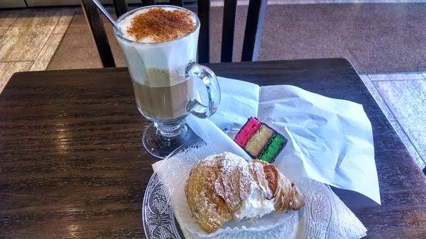 Cappuccino, rainbow cookie, Sfogliatella (lobster tail)