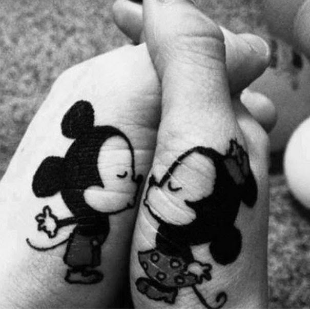 http://www.tattooset.com/tattoo/10884-tatuagem-mickey-e-minnie