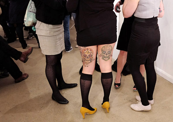 Yellow high heels matched with knee high stockings, back-of-leg, large skull tattoos; at opening, Street Fashion Sydney, Fujifilm X-Pro1