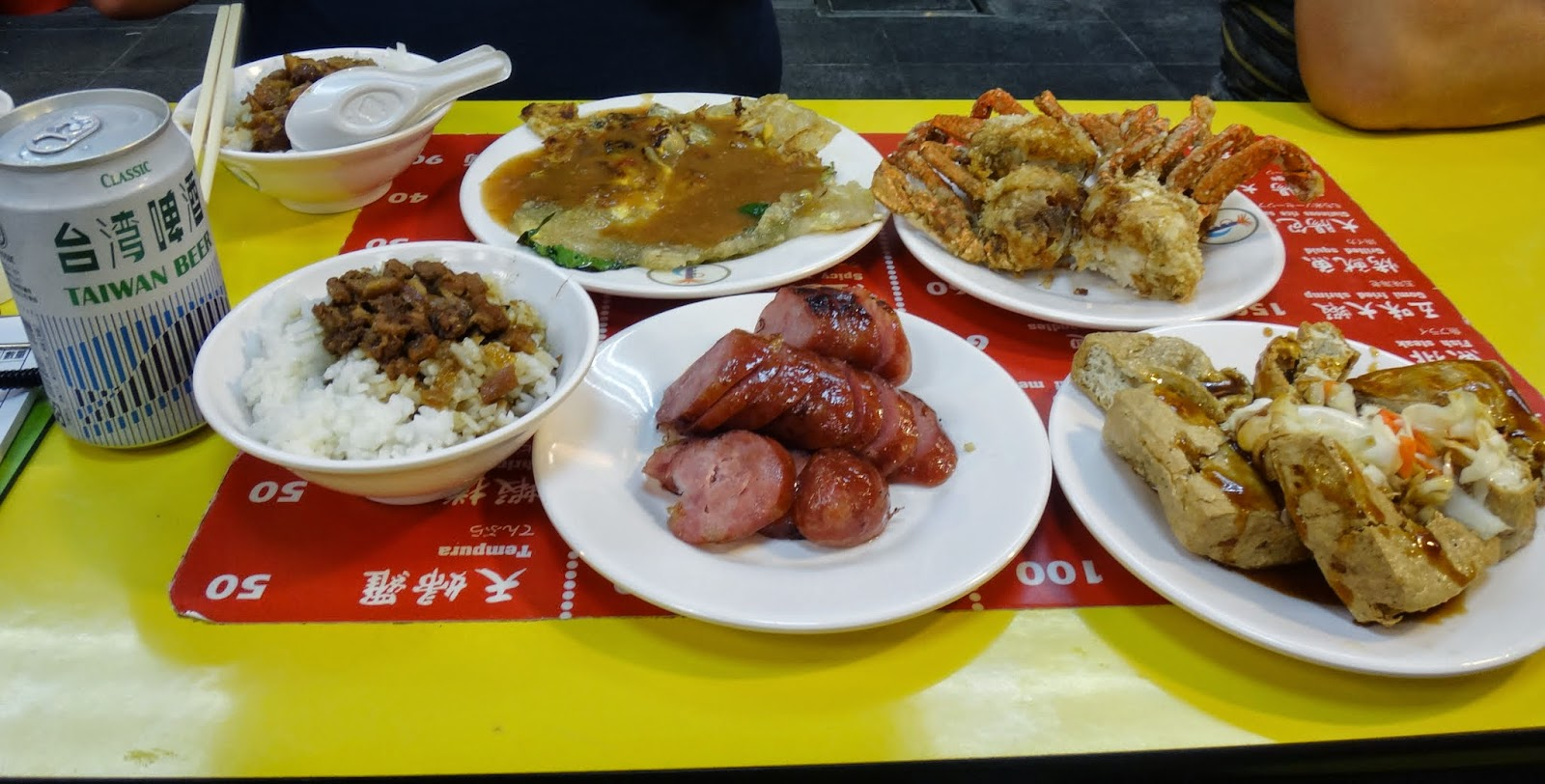 Our dinner costs TWD450 for fried crab, sausage, braised pork rice, fried oyster, stinky tofu and beer at Shilin Night Market in Taipei, Taiwan