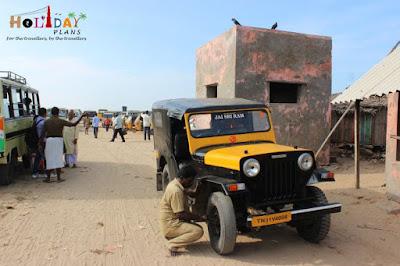 Driver modifying jeep for rough terrain ahead