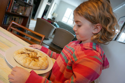 child with apple galette