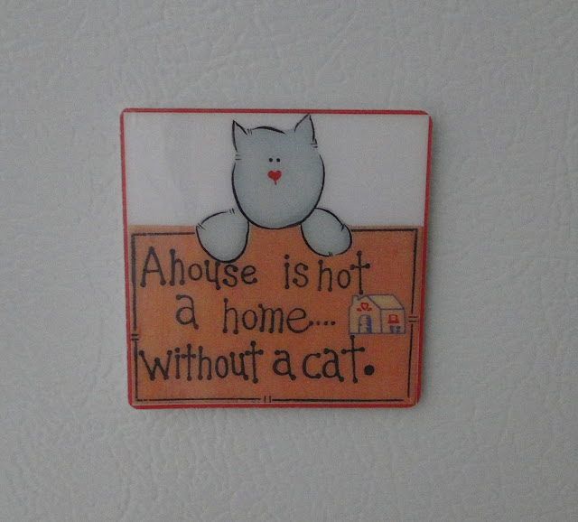 A house is not a home without a cat - Fridge Magnet
