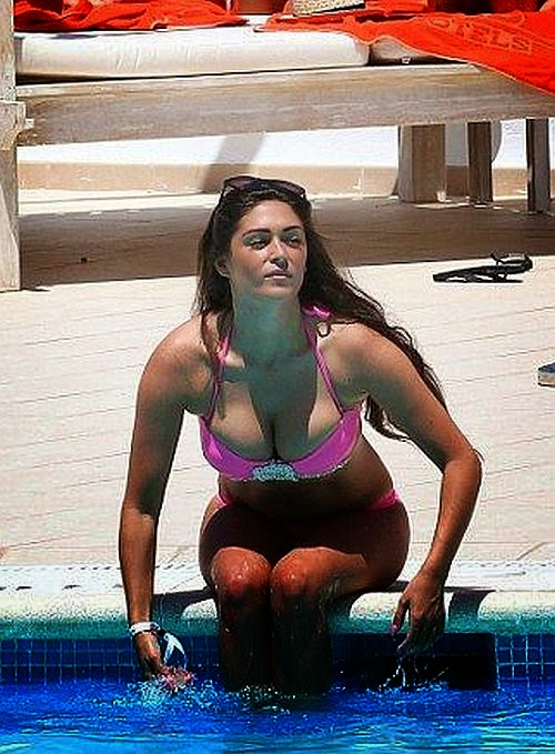 the British buxom, 29 flaunting her fabulous figure in fun tassel entertainment at the poolside in Ibiza on Saturday, July 5, 2014 with several female friends.