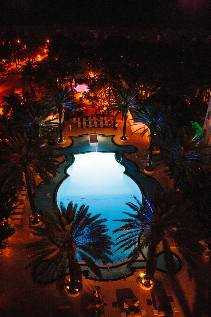penthouse view of the iconic raleigh hotel pool at night