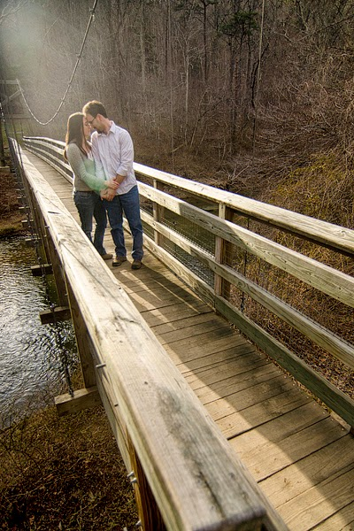 portrait of a couple on a bridge in front royal