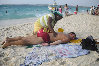 Getting 'rubbed-up' on a beach on Colombia's Caribbean coast by a 'strong-handed' lady. A much safer pursuit than hiring 'escorts'!