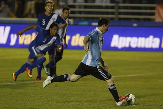 Lionel Messi scores a penalty against Guatemala for his 34th goal in Argentina colours