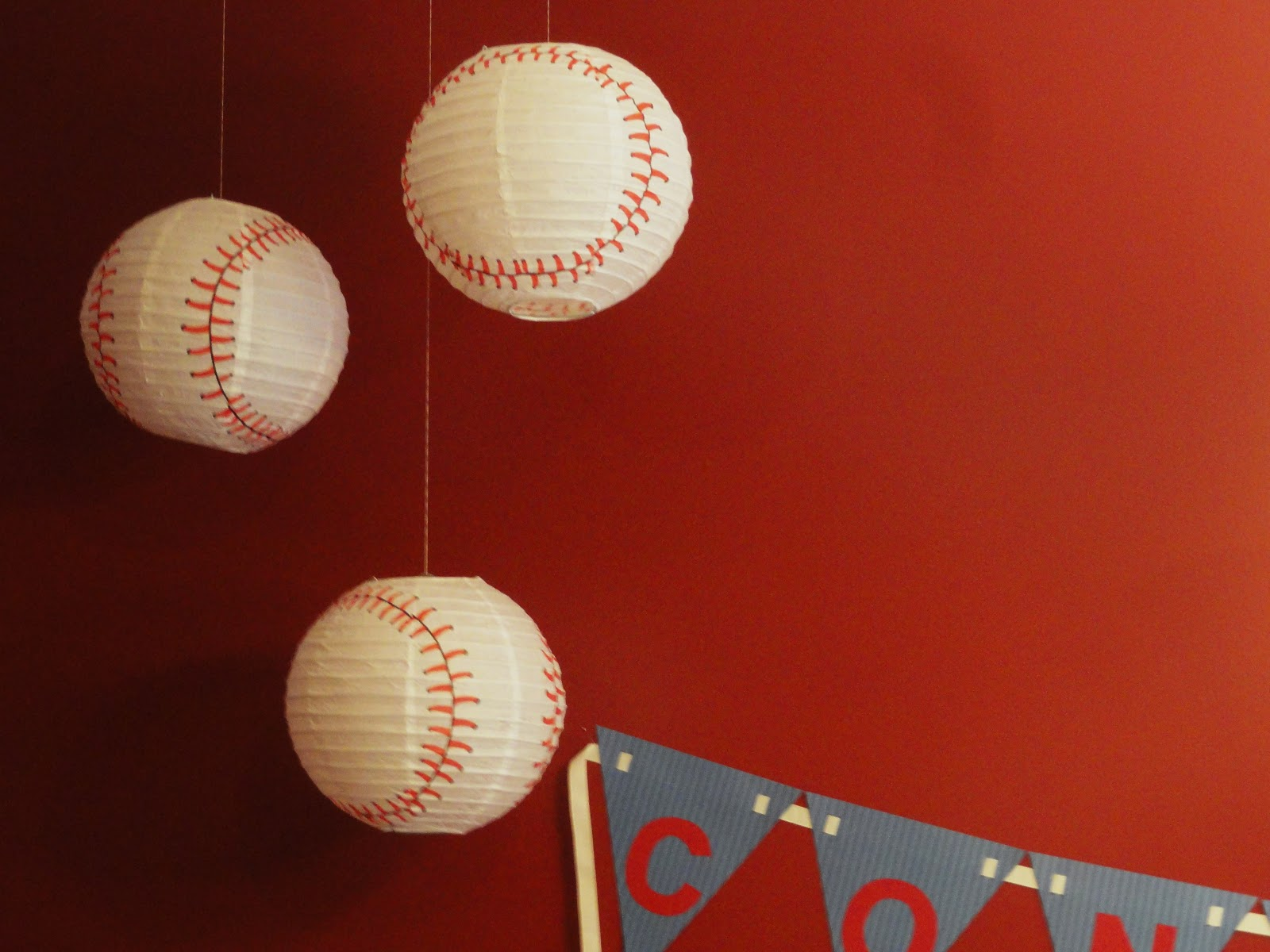 we found these baseball patterned lanterns at party city they came