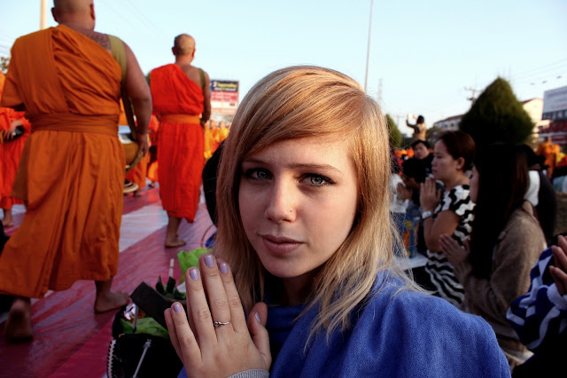 Monks alms-giving in Chiang Mai, South African in Thailand, young woman, traveller, praying