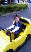 Eight-year-old boy driving Lego car