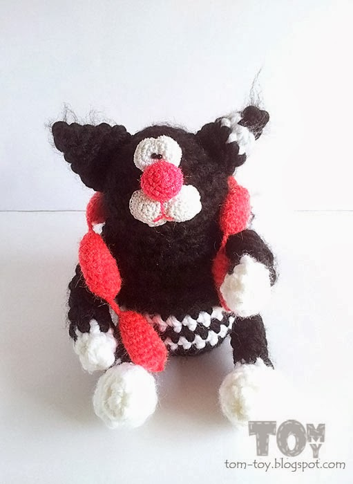 Crochet fat cat with sausages