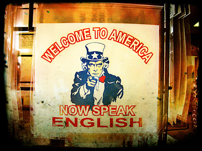 Poster: 'Welcome to America - Now speak English'