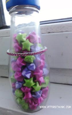 Folded stars in a glass bottle
