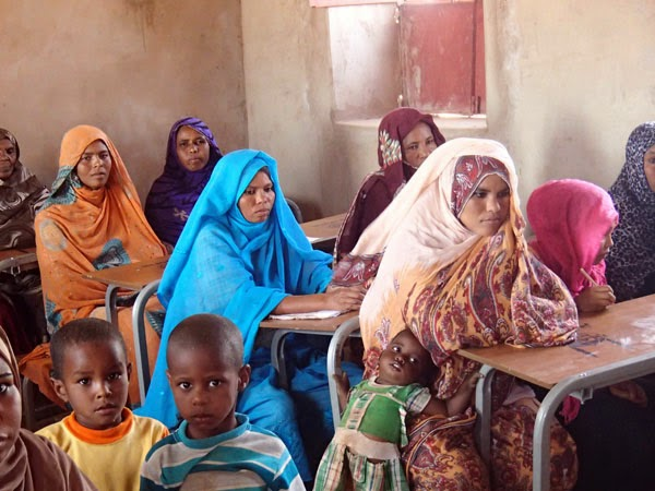 Women in a WEP class with their children