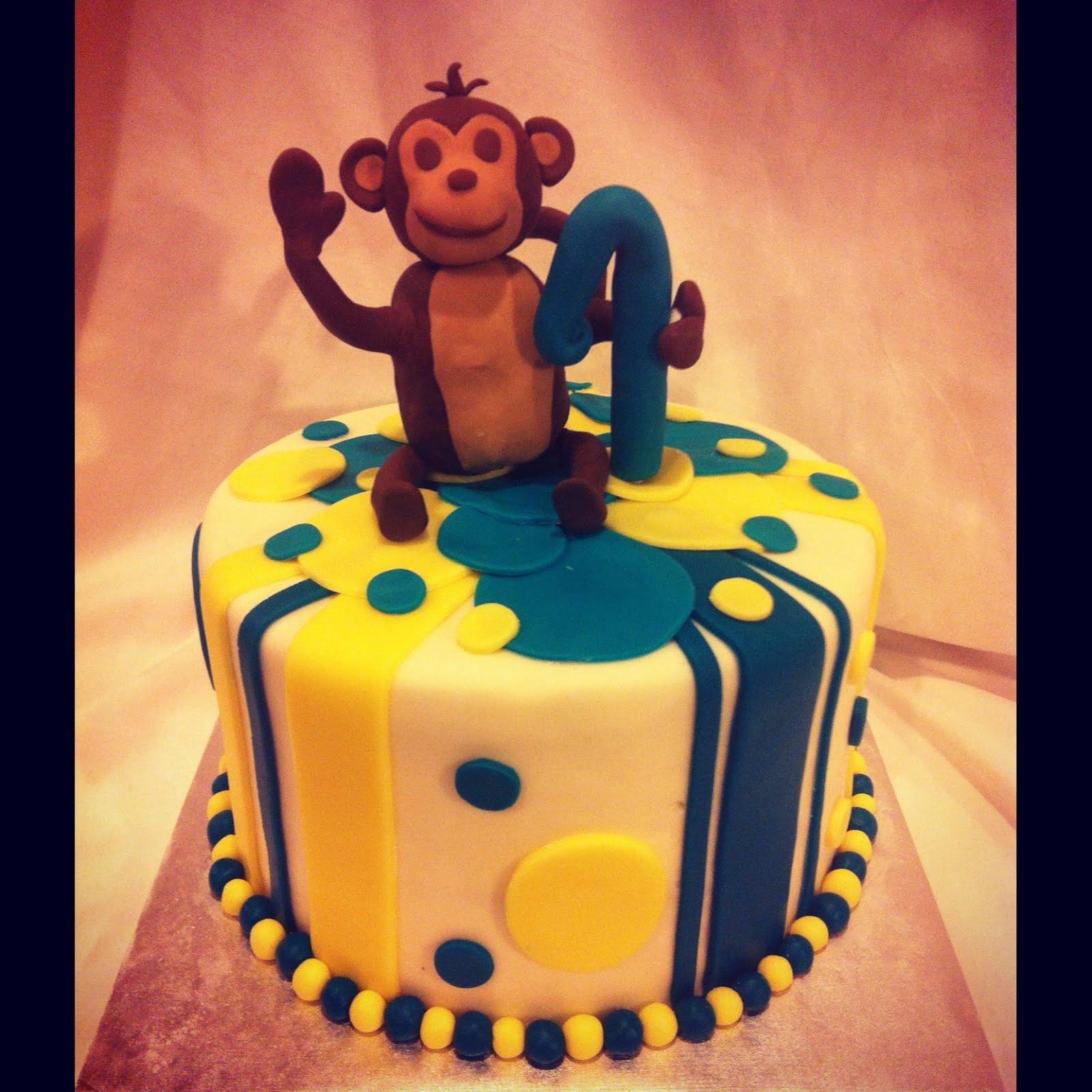 little boy got to enjoy this monkey birthday cake....with a monkey ...
