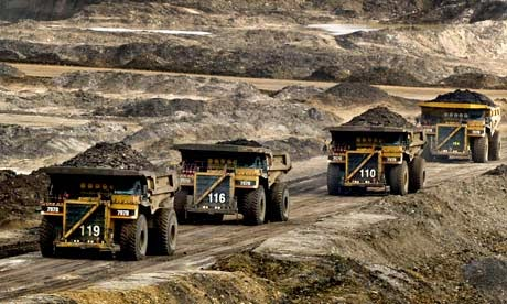Huge trucks transporting materials in Canada's oil sands