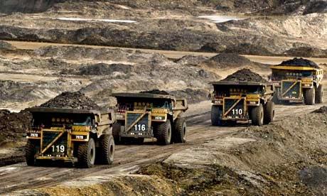 Huge trucks transporting materials in Canada's oil sands