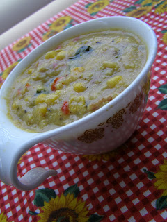 Maque Choux Soup in vintage handled cup on red checkered sunflower table cloth