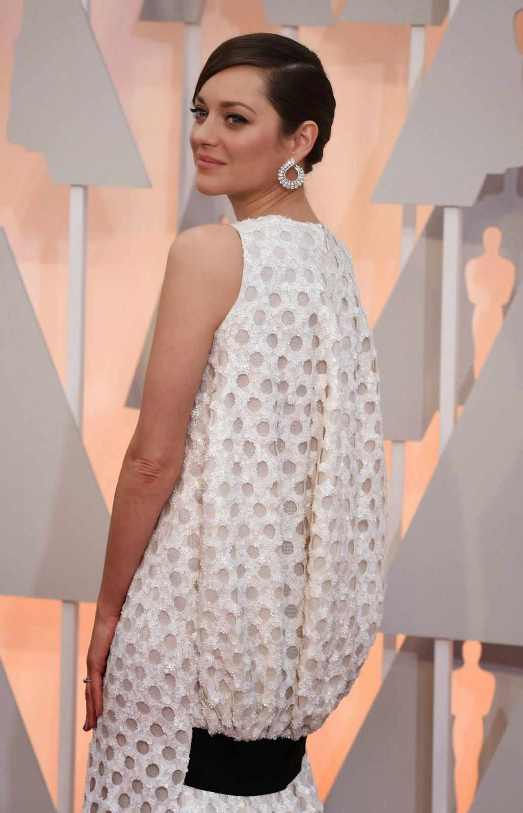 Marion Cotillard in a sequinned polka-dotted Dior dress at the 2015 Oscars in Hollywood