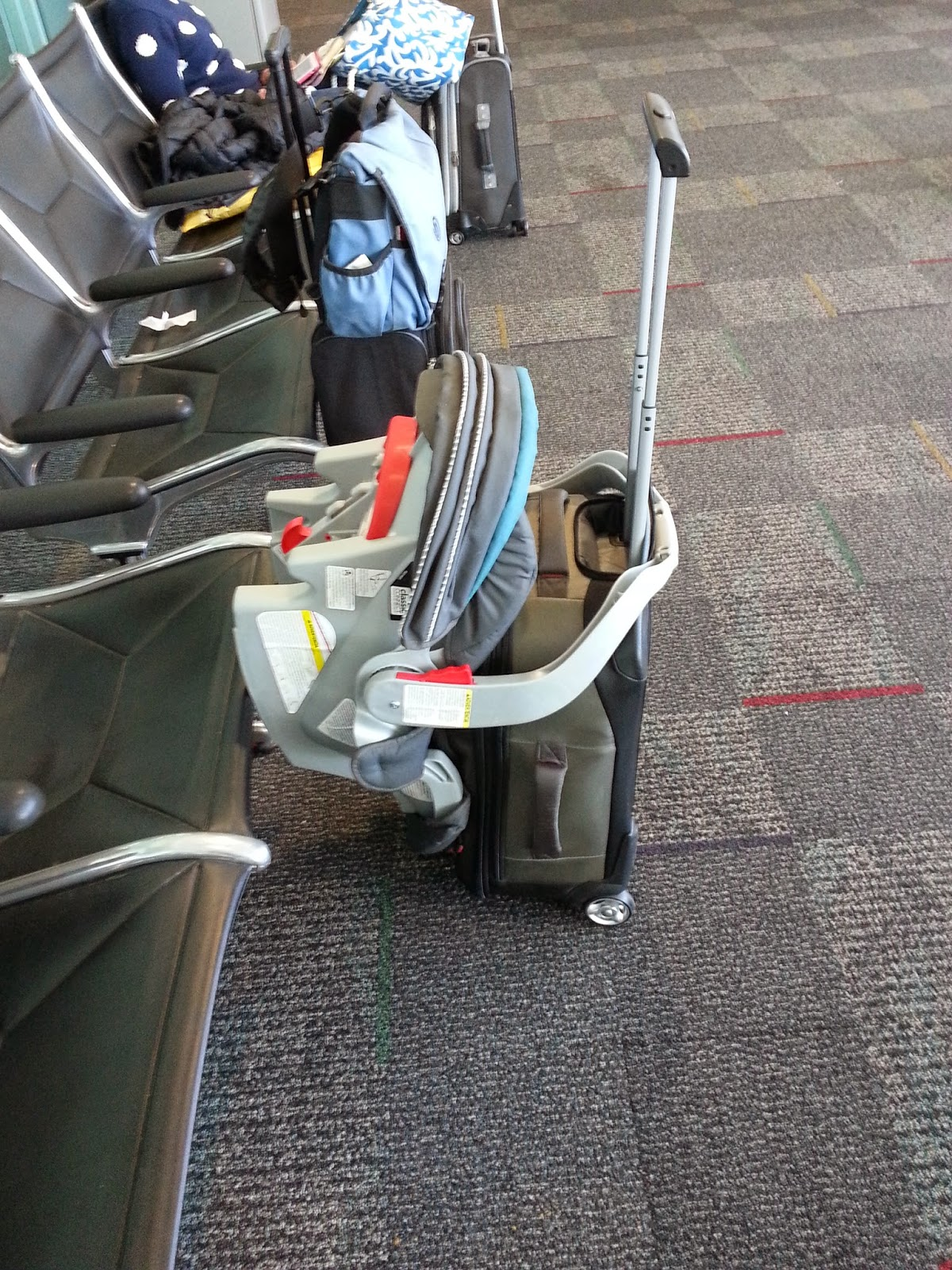A Car Seat That Is Gate Checked Can Be Slug Over Carry On Rolling Suitcase