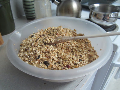Stirring a bowl of homemade granola