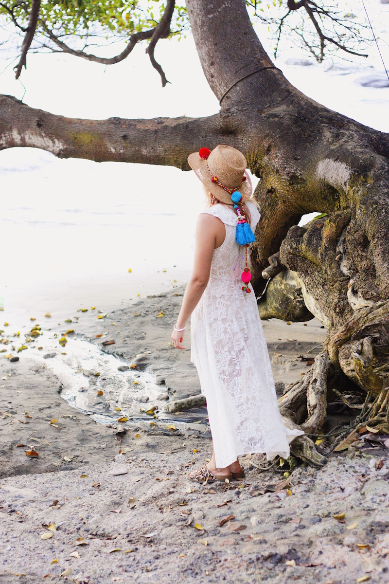 bohemian white lace up dress on carricitos beach in Sayulita, Mexico on Bryn Newman of Stone Fox Style