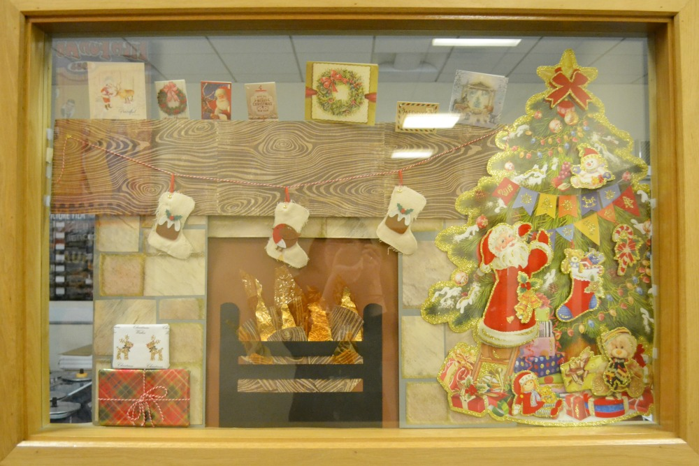 christmas window design display fireplace tree scene stockings